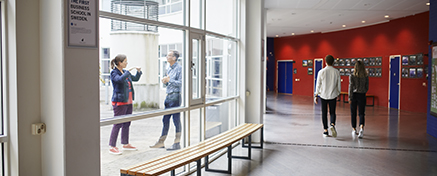 Two students walking in the corridor of JIBS