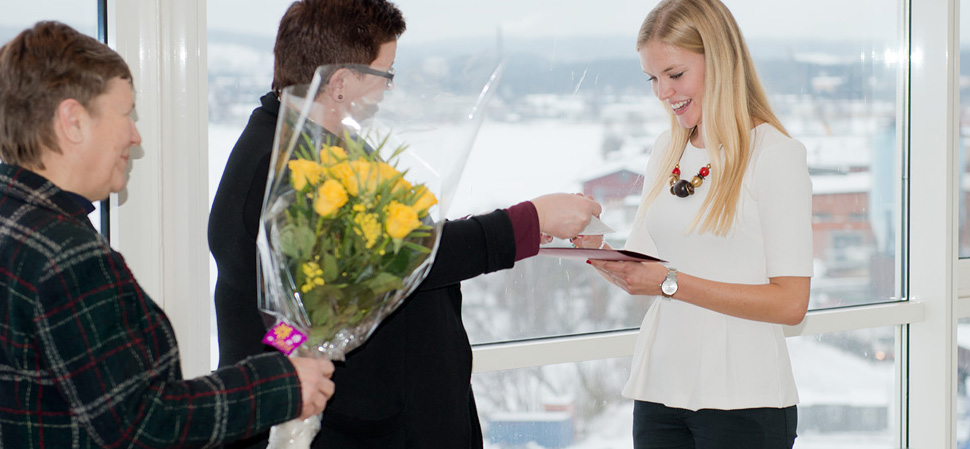 Student receiving scholarship and flowers